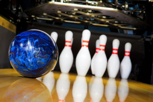 Bowling ball rolling toward the pins
